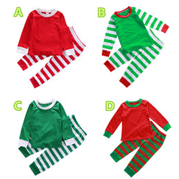 02ccbc680874a 2018 детские рождественские пижамы дети пижамы топ+брюки мальчик девочка 2  шт. наряды хлопок сплошной цвет полосатый Рождество детская одежда