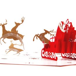 Wholesale flying laser - 10pcs lot Laser Cut Invitations Handmade Pop Up Card 3D Flying Deer Car Christmas Greeting Cards