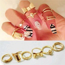 Wholesale Skull Gold Nail - 2016 New 7Pcs Punk Promotion Gold Color Skull Bowknot Heart Nail Simple Band Mid Finger Top Stacking Rings Set for Women P-080