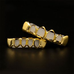 Wholesale hip hop teeth - New Style 18k Real gold plated Rhinestone Iced Out Hip Hop GANGSTER Bling Gold Teeth Grillz Top Bottom Grills Set Silicone Vampire Teeth