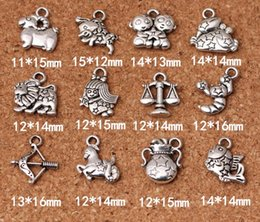 Wholesale Zodiac Sign Charms Wholesale - 12 Zodiac Signs Pendants Charms Tibetan Silver Two Sided Delicate Fittings Accessory for DIY Jewelry Making