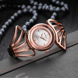 Wholesale Red Wedding Tags - New quartz watch female round fashion special modeling female models art wedding party watch