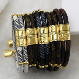 Wholesale Gold Stainless Steel Charm - New fashion double small accessories small lock leather bracelet titanium steel buckle leather rope bracelet