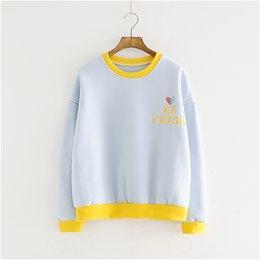 Argentina Primavera y otoño nuevo bordado suelta cuello redondo suéter mujeres párrafo corto versión coreana del color era delgada chaqueta de los estudiantes Suministro