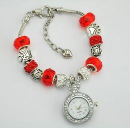 Argentina Moda única reloj de cuarzo de las mujeres de las señoras de cristal redondo en forma de etiqueta pulsera reloj de lujo de plata del brazalete adornos de diamantes supplier unique shaped watches Suministro