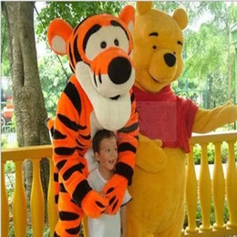 Wholesale Tigger Character Costumes - Tigger and winnie-the-pooh's mascot dressed as a costume cartoon character costume a fan of the cooling fan
