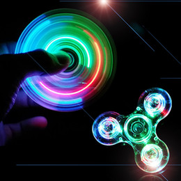 Wholesale 2017 New Product Transparent LED Light Fidget Spiner Windmill Glowing EDC Crystal Fire wheel Hand Finger Spinner Toys For Adults And Kids