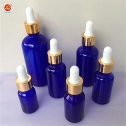 Wholesale blue droppers - Wholesale- Dropper Bottles 10ml 15ml 20ml 30ml 50ml 100ml Glass Dropper Bottles with Pipette Empty Blue Perfumes Bottles Liquid Jars 24pcs