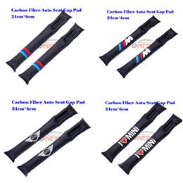 Hot seling 2 pz / lotto In fibra di carbonio seggiolino auto Gap Plug Inserti Crevice Imbottitura protettiva per M LOVE mini WING logo auto imbottitura del sedile da