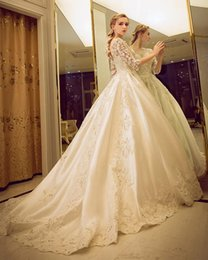 Wholesale Ribbon Palace - High-end luxury Ivory wedding dress long tail of the bride and groom to two kinds of style palace long sleeved skirt wedding dress
