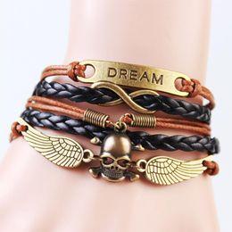 Wholesale Dream Infinity Bracelets - Wholesale-2016 New Handmade Fashion Skull Win Dream Charms infinity Bracelet Brown Black Woven Leather Punk Bracelet Best-selling