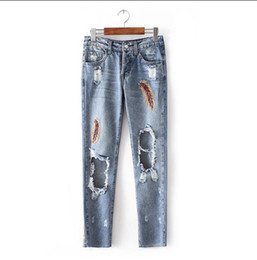 Wholesale Joker Cotton Jeans - The new women's clothing in Europe and the van age season joker hole feathers washed jeans embroidery female pants pants