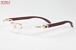 Wholesale clear lens wood glass - New 2017 Luxury Brand Wood Sunglasses Metal Gold Frame Clear Lens Glasses Sunglasses For Men Rimless Buffalo Horn Sun glasses With Box Case