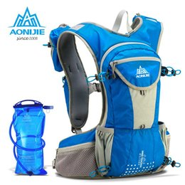 Wholesale Hydration Water Bags - Wholesale- AONIJIE 12L Running Nylon Backpack Outdoor Lightweight Hydration Sport Bag Climbing Cycling Hiking With 2L Water Bag