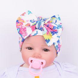 Wholesale Big Flower Hats - Newborn hat Baby girl Beanie Big bow knit hat Maternity Flowers Print Boutique warm European Hotsale Autumn winter wholesale 0-3months 2016