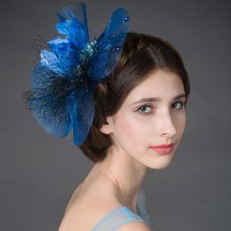 Moda azul pluma nupcial tiaras tul cabeza piezas envío rápido nupciales  diademas tiaras coronas boda accesorios para el cabello plumas de pelo  nupcial ... 7a970c45f31