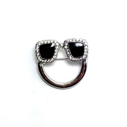 Wholesale Designer Crystal Brooches - Wholesale- New designer crystals black enamel charm eyeglasses holder pin brooch badge fashion jewelry 6pcs lot free shipping