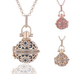 Wholesale Heart Pendant Metal - 2017 Hot Ball Harmony Necklaces Round Hollow Heart Pendant Chains Copper Metal Maternity Angel Ball Pendant Jewelry With Chains 3 Color