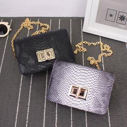 Wholesale Wild Fashion Bags - New wave designer bags European and American women fashion retro serpentine lock simple wild shoulder Messenger bag chain women small squa