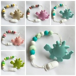 Wholesale Infant Kids Toys - new 2017 silicone teether baby Pacifier clip kids baby dinosaur chewing toy infant food grade silicone teething beads pacifier holder chew