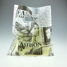 Wholesale Plastic Shopping Bags Black - Wholesale- Hot Sale 20x25cm Black Newspaper Design Plastic Shopping Bags 100pcs lot Clothes Gift Packaging Plastic Bag With Handle