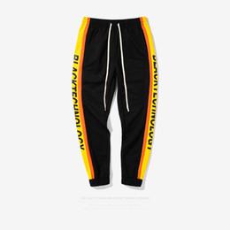 Wholesale Women S Hip Hop Sweatpants - 2017 Autumn Streetwear New Fashion Hip Hop Pants Hit Color Stripes Letter Women Men Elastic Pants Skateboard Sweatpants