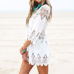 0a73816c6a1e6 Summer Women Beach Mini White Dress Elegant 3 4 Sleeve O Neck Lace Floral Crochet  Hollow Out Solid Beach Dress Vestidos Cover Up Beachwear