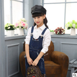 Wholesale Children S Denim Fashion - New 2017 Children 's Clothing Denim Overalls Jeans Spring and Autumn Girls Fashion Cowboy Blue Solid Color Size4-14 ly227