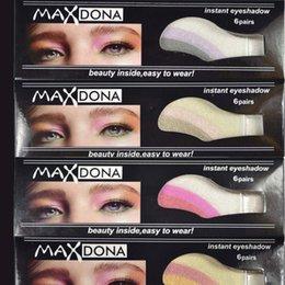Al por mayor-6 pares de herramientas de maquillaje portátiles Una vez de palo de sombra de ojos Dazzle color Majic pegatinas de sombra de ojos brillo paleta de sombra de ojos maquillaje desde fabricantes