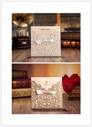Wholesale elegant floral cut wedding invitations - Wholesale-2015 new 50pcs set free envelop and free seal Elegant Floral laser Cut pocket Wedding Invitation with tie CW5011CW5002