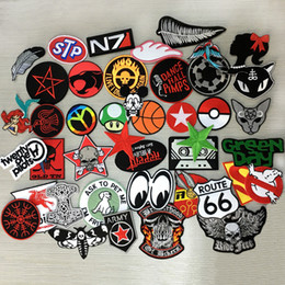 Wholesale N7 evil cat Mixed Brand Logo Iron On skull cartoon Patch Sew Embroidered Hat Shirt DIY Music Rock Punk Metal