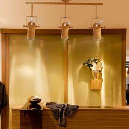 Montaje de barra de techo online-La personalidad creativa de la barra de bambú de la barra larga de la sala de estar sola cabeza 5W LED tienda de ropa montada downlights montado