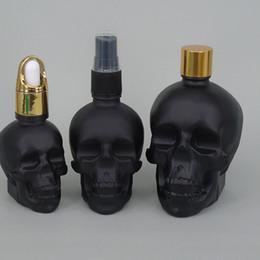 Wholesale Online Bottle - Online glass skull ceramic bottle frosted black e liquid dropper bottle wholesale 30ml glass skull bottle with dropper for e jucie liquid