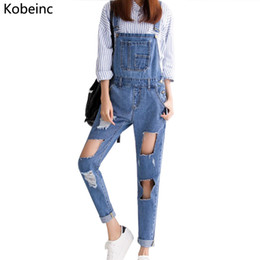 Wholesale Jean Rompers - Wholesale- Fashion High Waist Strap Denim Overall Solid Color Retro Blue Ripped Big Hole Jumpsuits Casual Pocket Button Jean Rompers S-XL