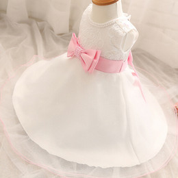 Wholesale Linen Lace Wedding Dresses - Wholesale- Summer Pink Bow White Princess Dress Baby Girl Wedding Dress Pearl O-Neck Infant Full Month or 1 Year Birthday Party Dress