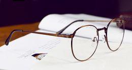 Quadros de metal ópticos retro homens / mulheres de moda armações de óculos redondos para prescrição 2957 de