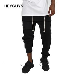 Wholesale jumpsuits for men - HEYGUYS 2017 jumpsuit skin fit sweat pants for men pants joggers workout sweatpants hip hop street wear high quality 17603