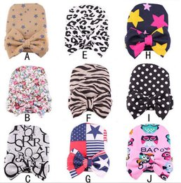 Wholesale Knit Hat Photograph - Baby Kids Hats Hospital Newborn Baby Knit Beanies With Bow Warm Sleep Cotton Toddler Cap Kids Photograph Prop Hat