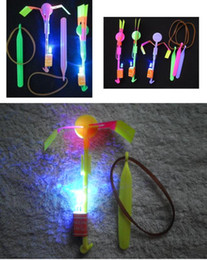 Wholesale Light Up Umbrella Wholesale - The factory price LED Light Flash Flying Elastic Powered Arrow Sling Shoot Up Helicopter helicopter umbrella kids toy y91