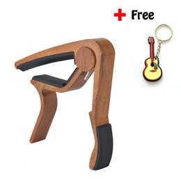 Wholesale Quick Change Capo - 6-String Wood Grain Acoustic Guitar Capo Single Handed Quick Change High Capo Quick Change Key Tune