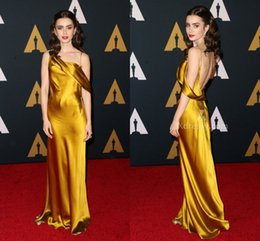 9b9e3bc4f50 Sexy Lily Collins Oscar Red Carpet Celebrity Dresses Sheath Gold Open Back  Asymmetrical Neck Satin Prom Dress Evening Party Gowns Cheap 2016