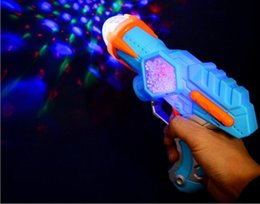 Wholesale Electric Music Rotating - New electric toy gun music light flash rotating projection gun children 's toy gun boy toys wholesale