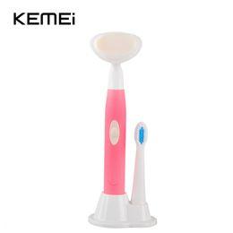 cepillo de alta frecuencia Rebajas Cepillo de dientes eléctrico especial rotativo a prueba de agua y cepillo de cara eléctrico 2 en 1 para adultos KEMEI KM-3106 de alta frecuencia