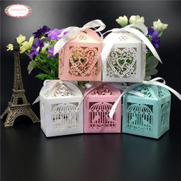 Wholesale Laser Cut Gift Box Design - Wholesale-50pcs Mult Designs Laser Cut Candy Chocolate Box Packaging Wedding Favors Decoration Love Heart Bird Cage Bridge Groom Gifts