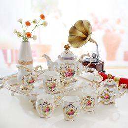 Wholesale European Tea Sets - Porcelain coffee set bone china flowers design outline in gold 8pcs European tea set coffee pot coffee jug tea cup tea tray