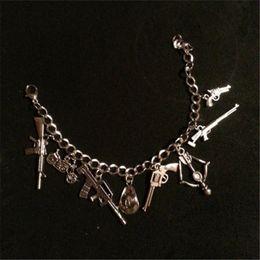 Encantos de la pulsera de la flecha del arco online-12pcs The Walking Dead Inspirado Zombie Charm Bracelet Bow Arrow Motorbike Sheriff's Hat Gun's Charms pulsera