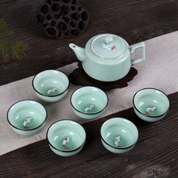 Wholesale Tea Fishing Cup - High-grade celadon fish cups tea gift custom printing can be printed logo Kung Fu tea sets ceramic carp