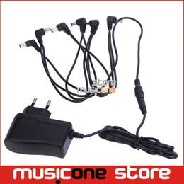 alimentation électrique pour effets de guitare Promotion En gros-Chinois Guitare Effet Pédale D'alimentation EU Plug 9V 6 Way Out entrée 100-240V MU0889