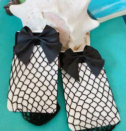 Wholesale Women S Fashion Socks - Fashion 2017 Women Bowknot Fishnet socks 2017 Summer Sexy Bowknot Women Short sexy Socks Transparent Fishnet Socks Girls Female Net Sheer S