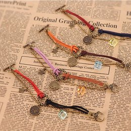 Wholesale Bronze Charm Bracelets - Vintage 12 Constellation Charm Bracelets With Antique Bronze Round Charm Leather Rope Bead Chain Fashion Jewelry Best Gift